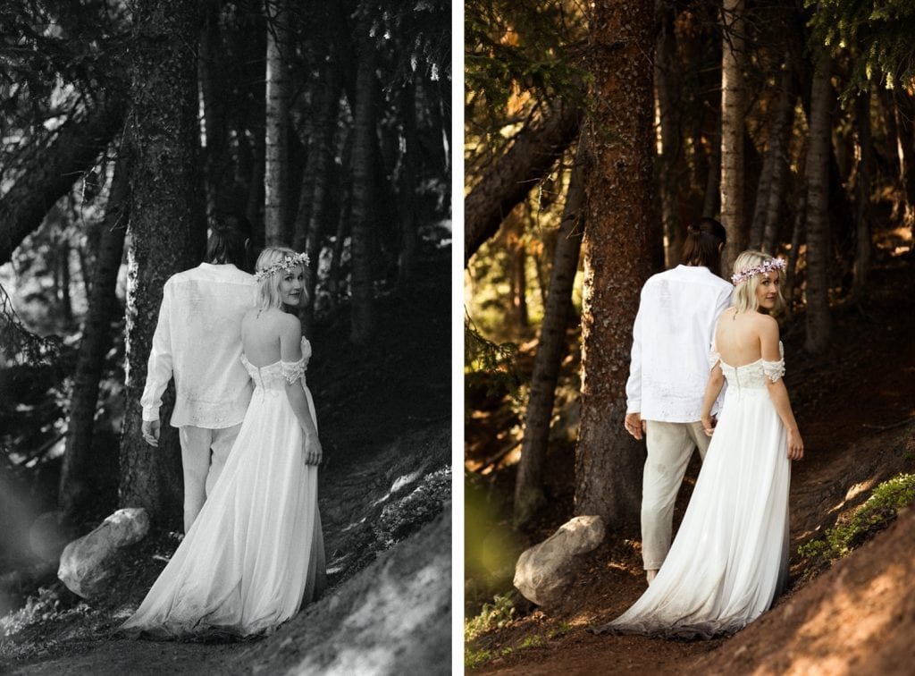 eloping couple hiking through the forest after their wedding