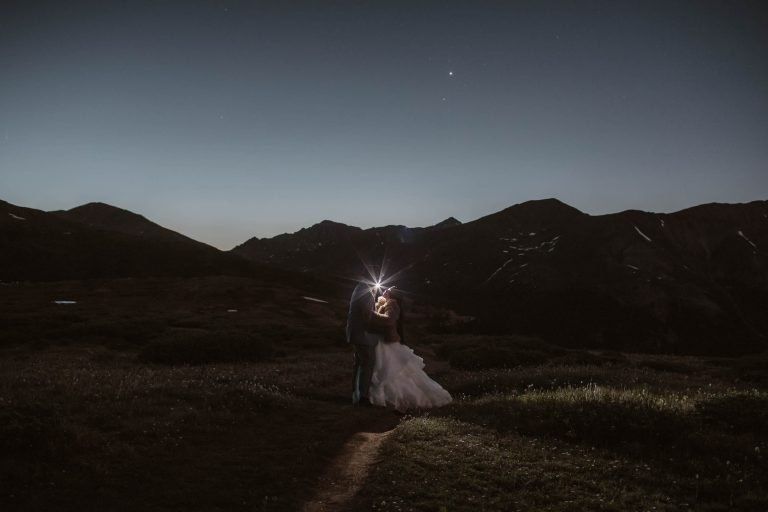 Aspen Colorado elopement photographers photographing a couple hiking at night for their elopement