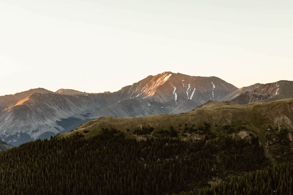 alpenglow at a Colorado elopement location in Aspen photographed by adventure wedding photographers