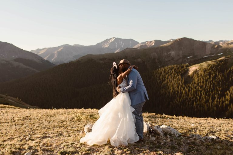 first kiss photographed by Colorado elopement photographers during a sunrise adventure wedding ceremony