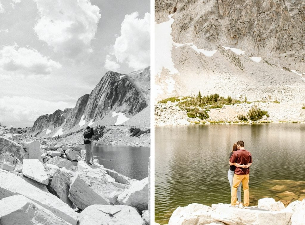 couple kissing on a mountaintop during their engagement