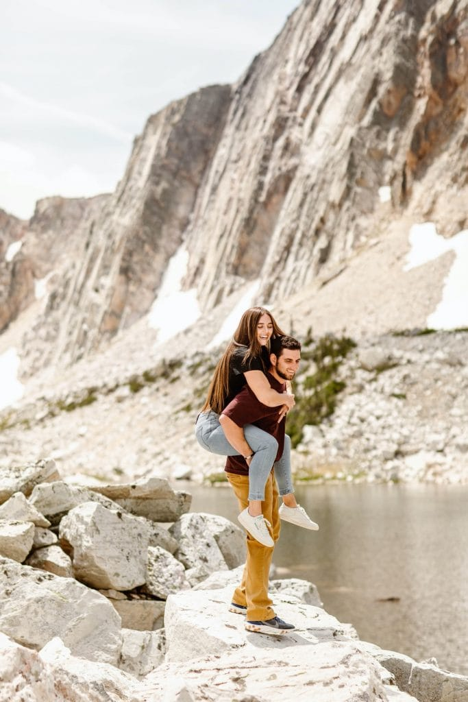 piggy back ride during mountain engagement photos in Wyoming