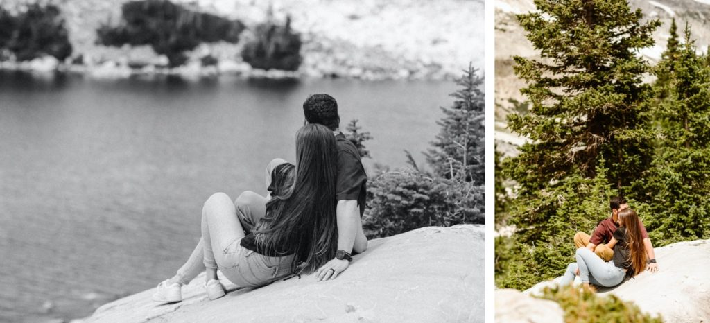 couple sunbathing on a rock together by the lake while having their mountain engagement photos taken