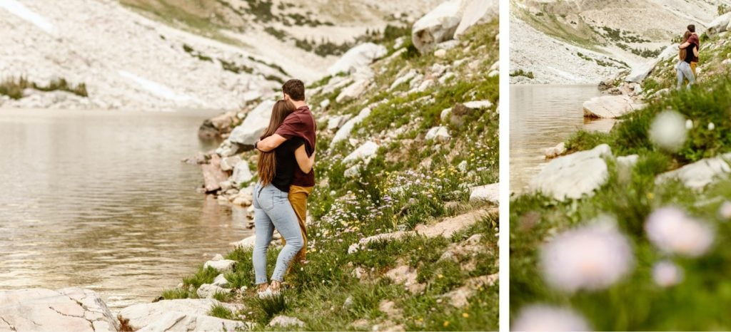 mountain engagement photos of a couple hiking by an alpine lake