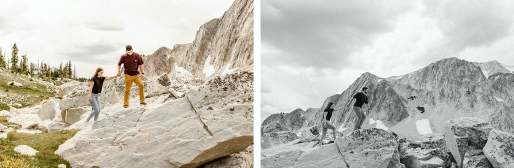 man leading woman up a mountain during their mountain engagement photos
