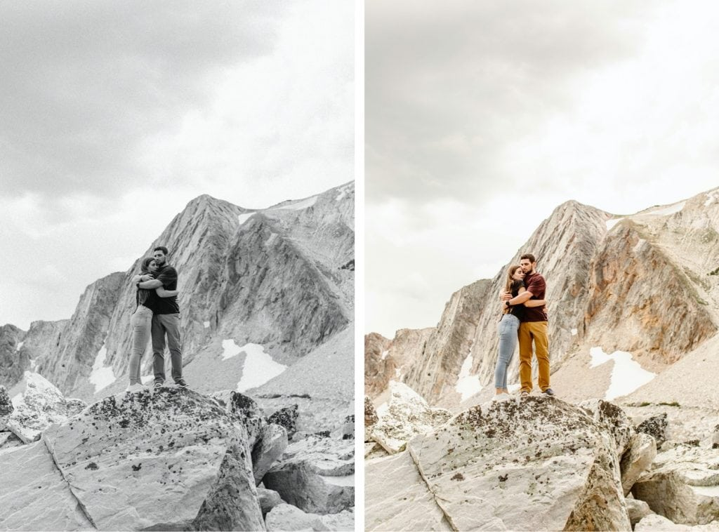 engaged couple hugging on a mountaintop in Wyoming