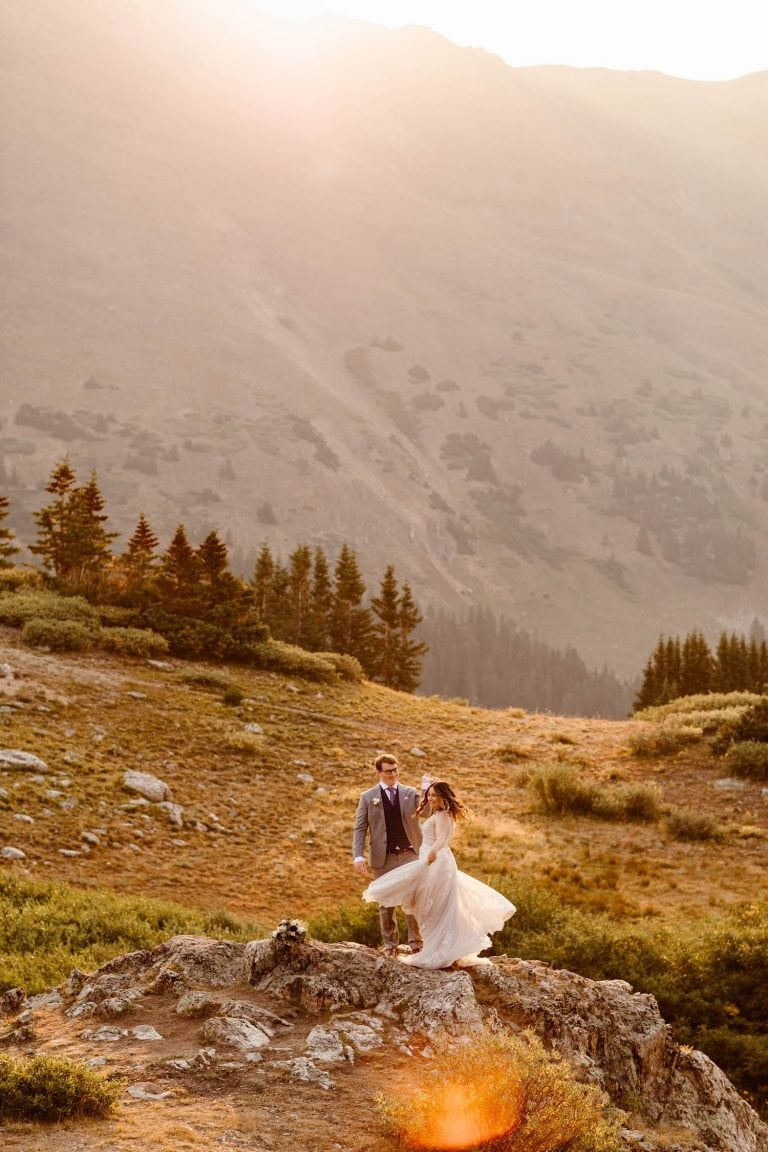 Rocky Mountain adventure wedding documented by Colorado elopement photographers | eloping couple dancing in the sunlight