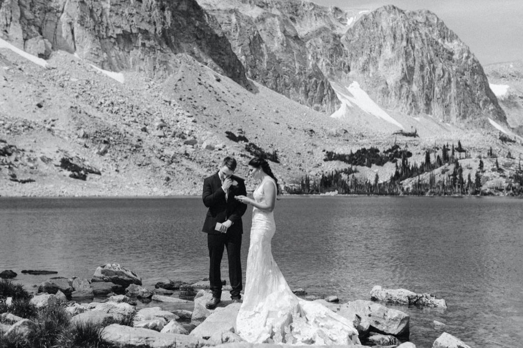 bride reading vows to groom during Wyoming wedding ceremony