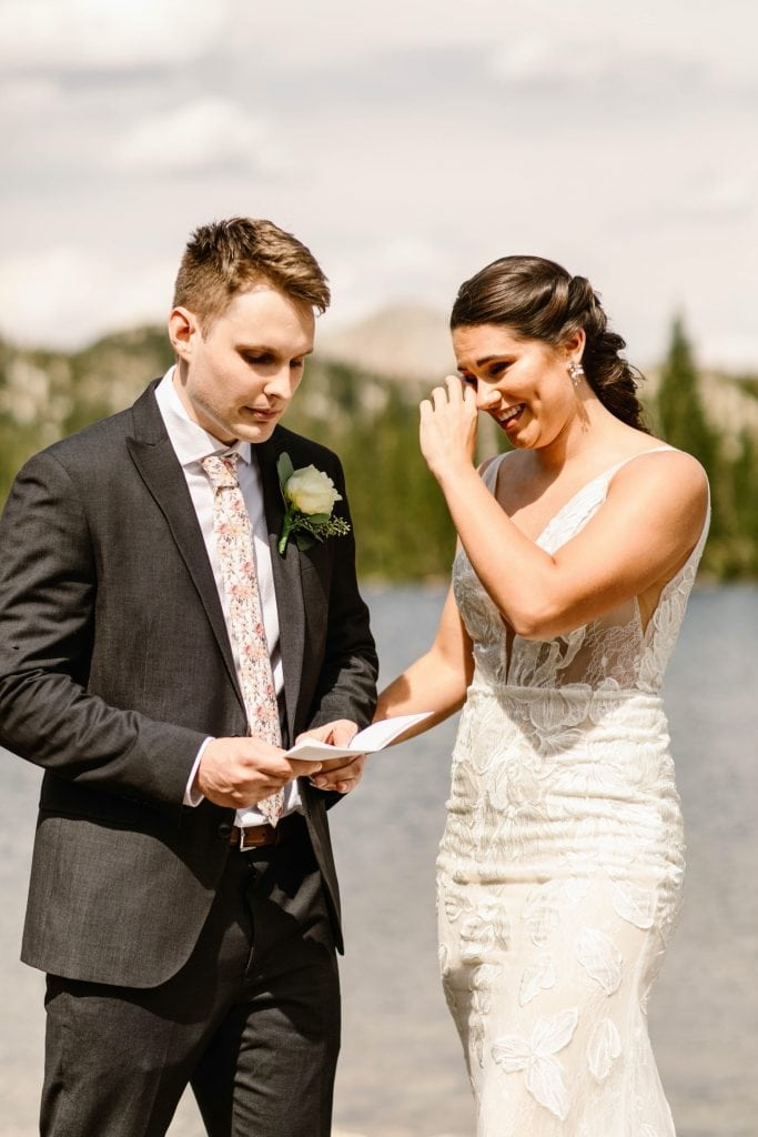 groom reading his vows to bride during Wyoming wedding ceremony