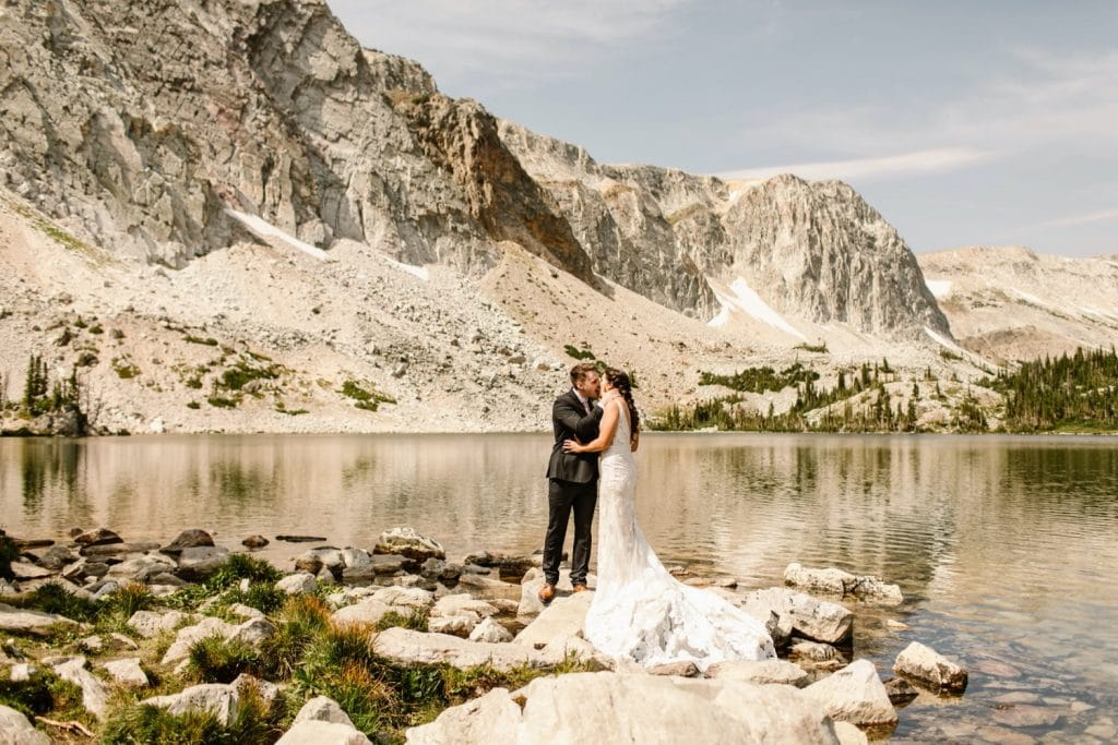 couple sharing their first kiss during their Wyoming wedding ceremony