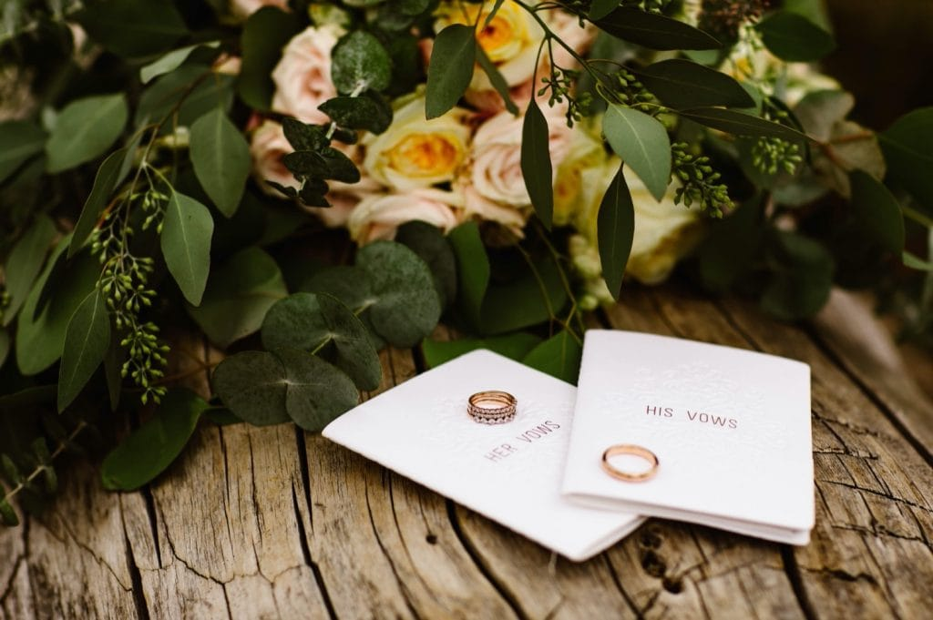 Wyoming wedding vow books with ring sitting on them