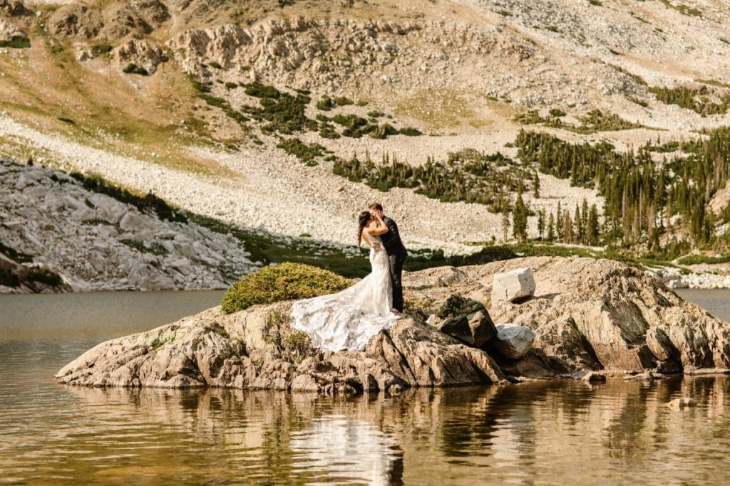 Wyoming wedding couple kissing on an island in an alpine lake