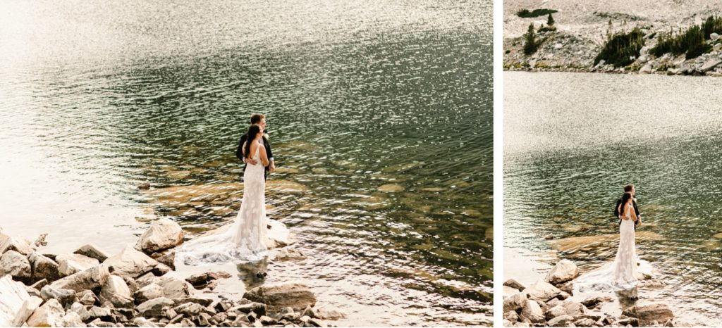 bride and groom standing lakeside during their small Wyoming wedding