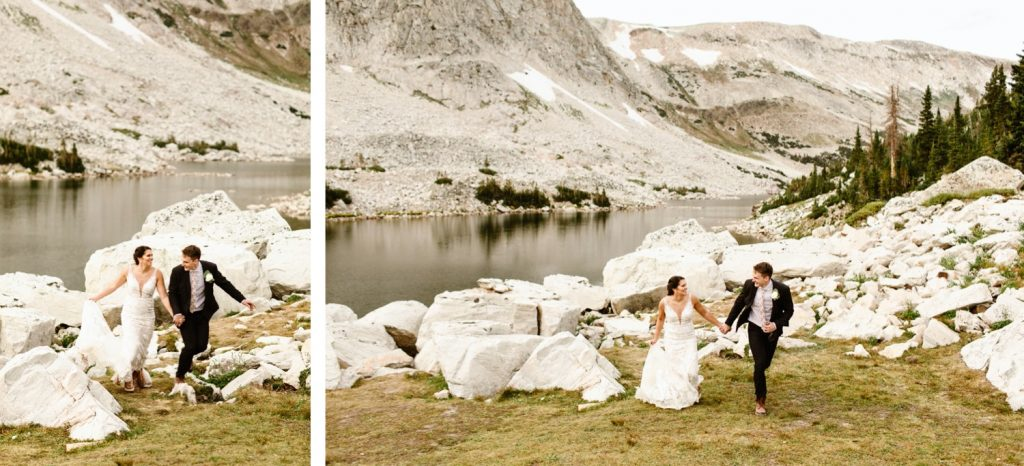 bride and groom running together in the mountains