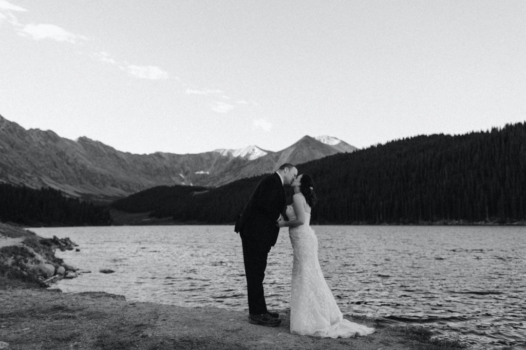 couple sharing their first kiss during their destination elopement ceremony