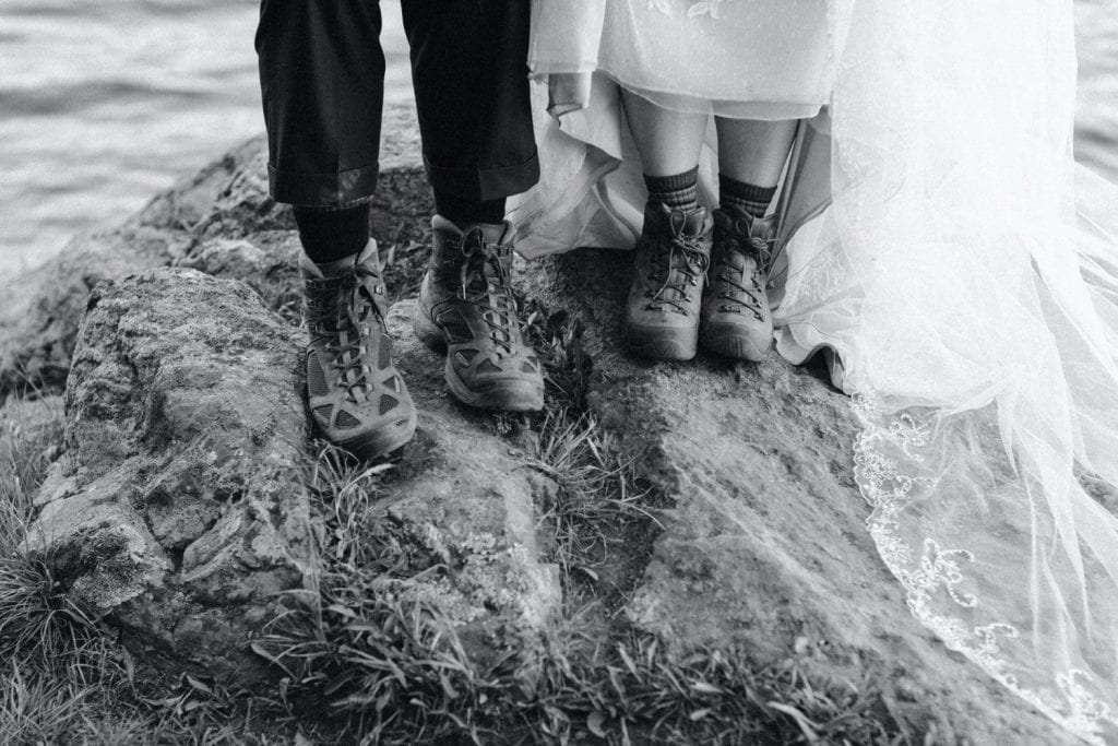 couple wearing hiking boots during their elopement
