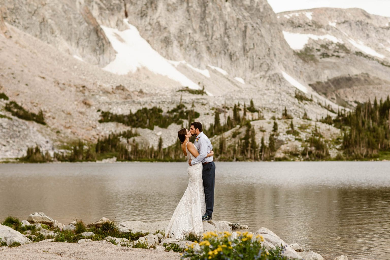 how much does it cost to elope | couple eloping in the mountains by an alpine lake