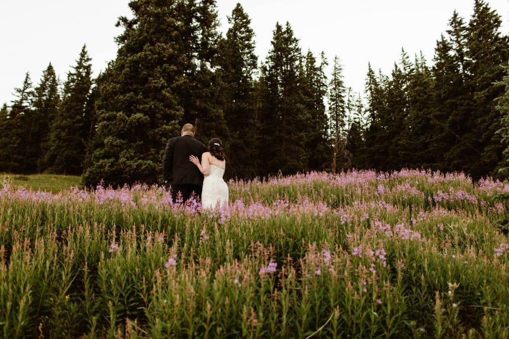 couple eloping in a wildflower field