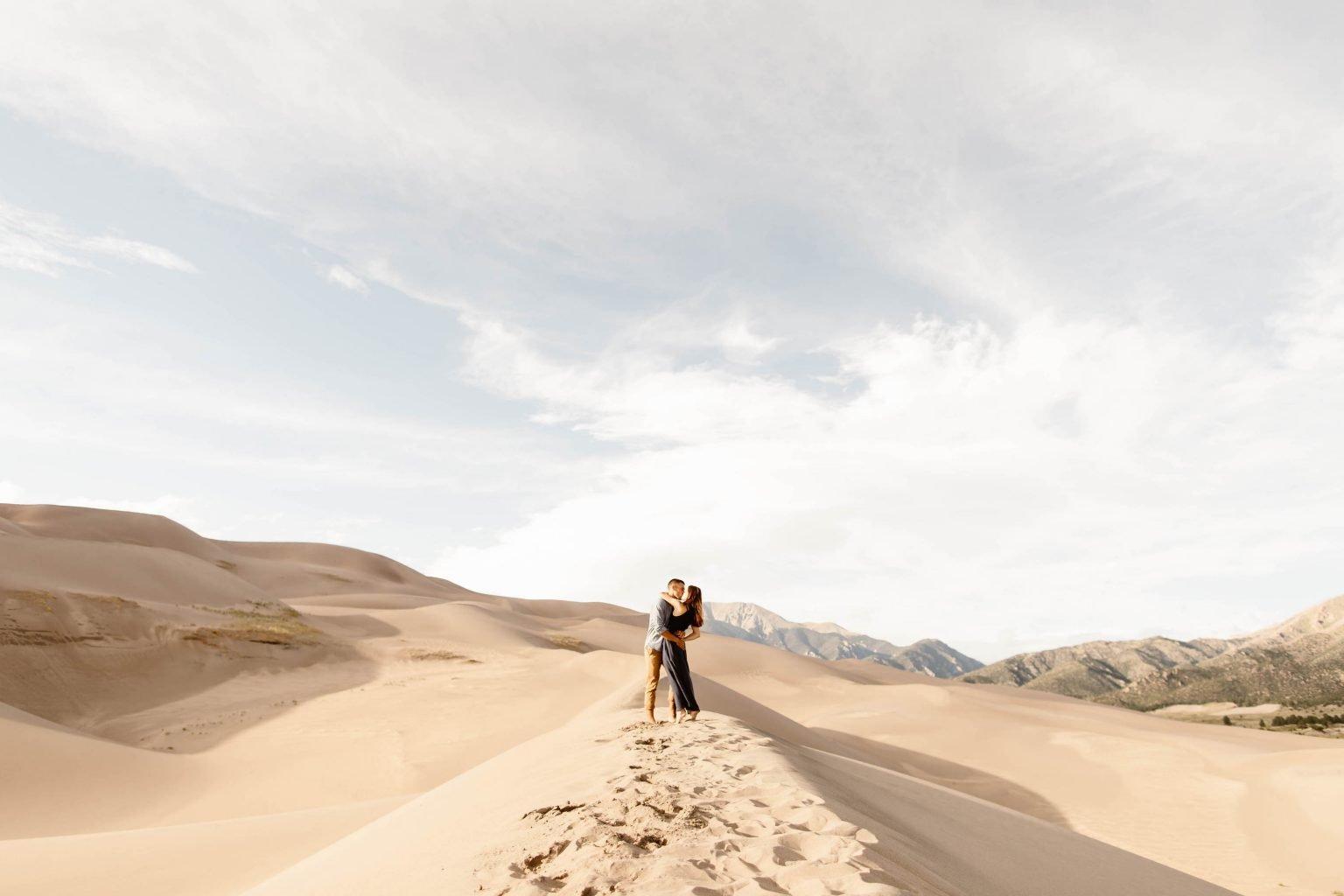 sand dunes engagement photos taken at sunset