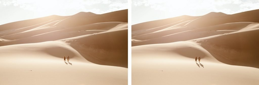 couple running down the giant dune field during their sand dunes session