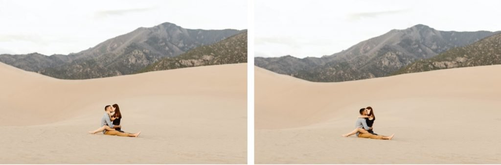 sand dunes engagement photos of couple kissing while sitting on the sand