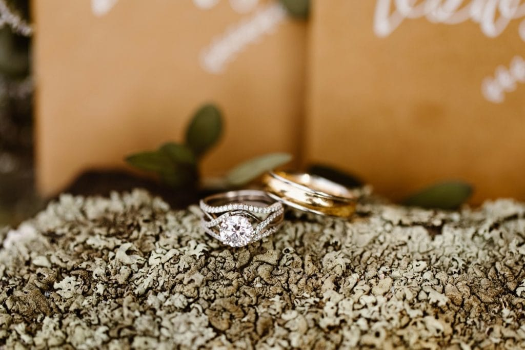 vow books and rings for a sunrise elopement