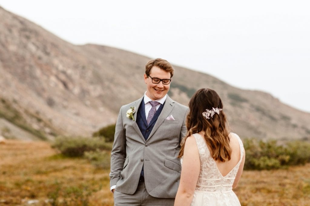 groom seeing bride for the first time before their sunrise elopement ceremony