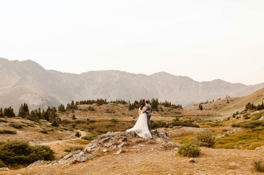 couple adventuring in the mountains after their sunrise elopement ceremony