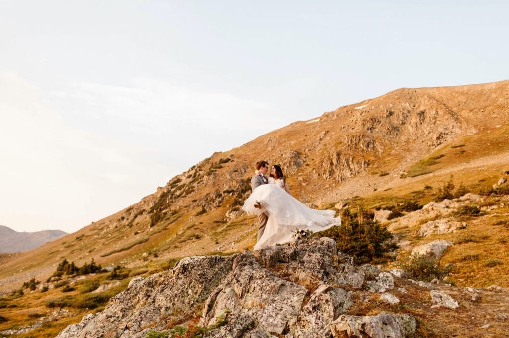 groom spinning bride during their sunrise elopement photos
