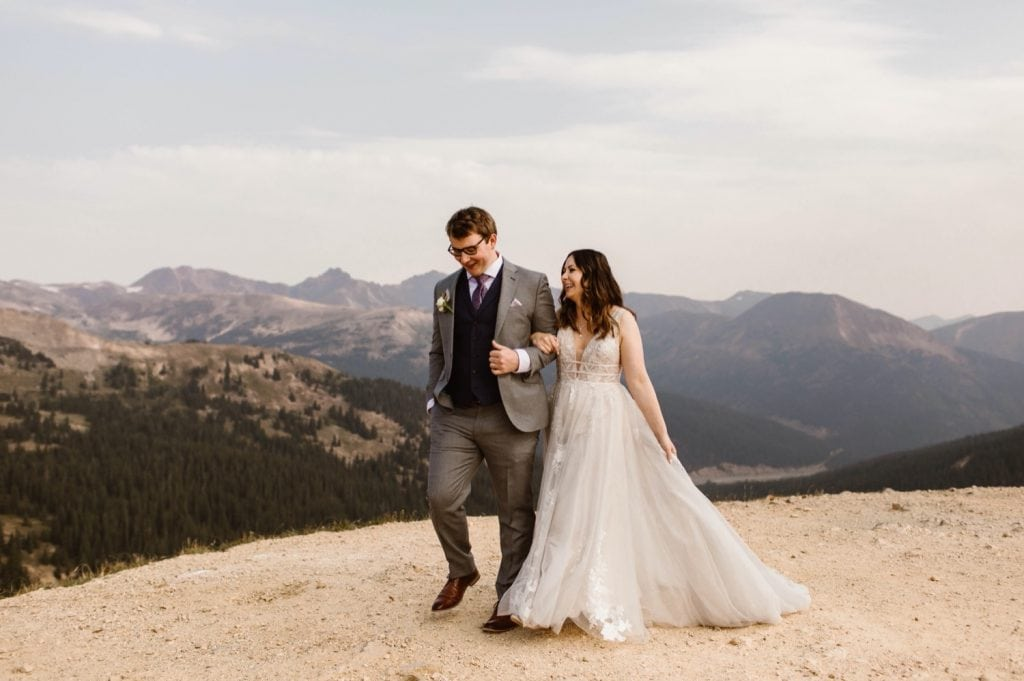 eloping couple sharing their first dance on the top of a mountain at sunrise