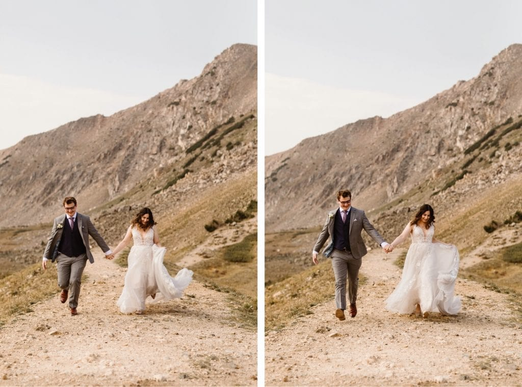 bride and groom running down a trail
