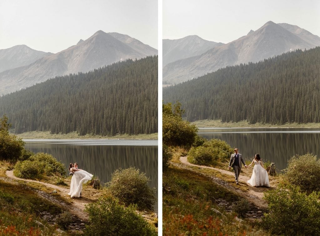 couple walking by a lake near Breckenridge after they eloped at sunrise
