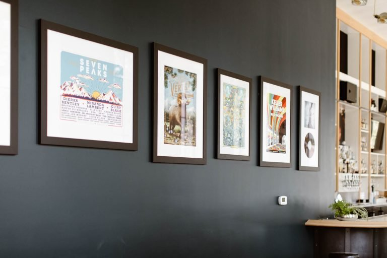 music prints hanging on the wall in the lobby of the Surf Hotel BV