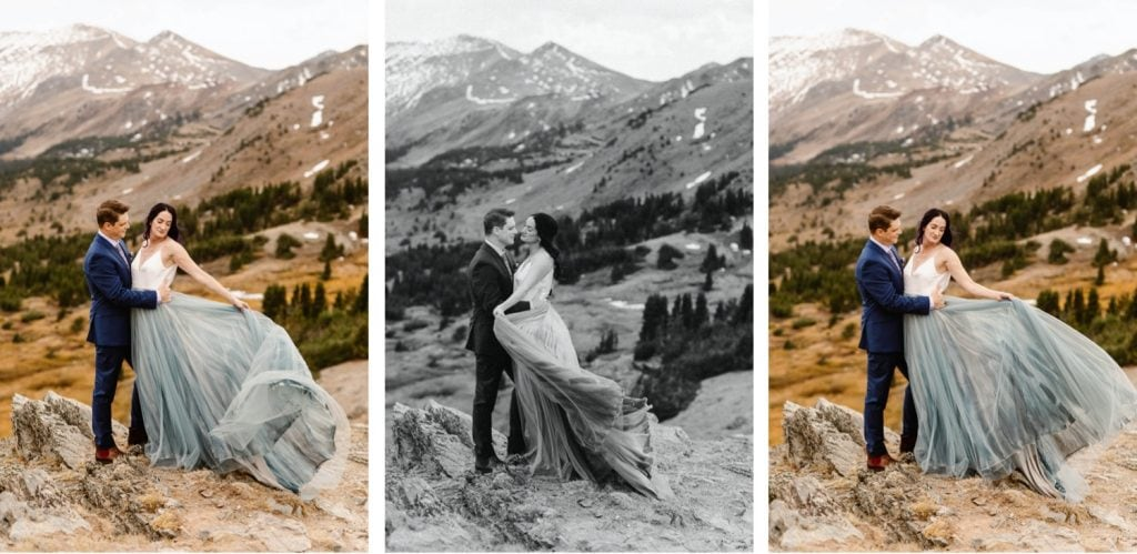 couple standing on the edge of a cliff in the mountains before their Buena Vista elopement ceremony | bride waving her dress in the wind
