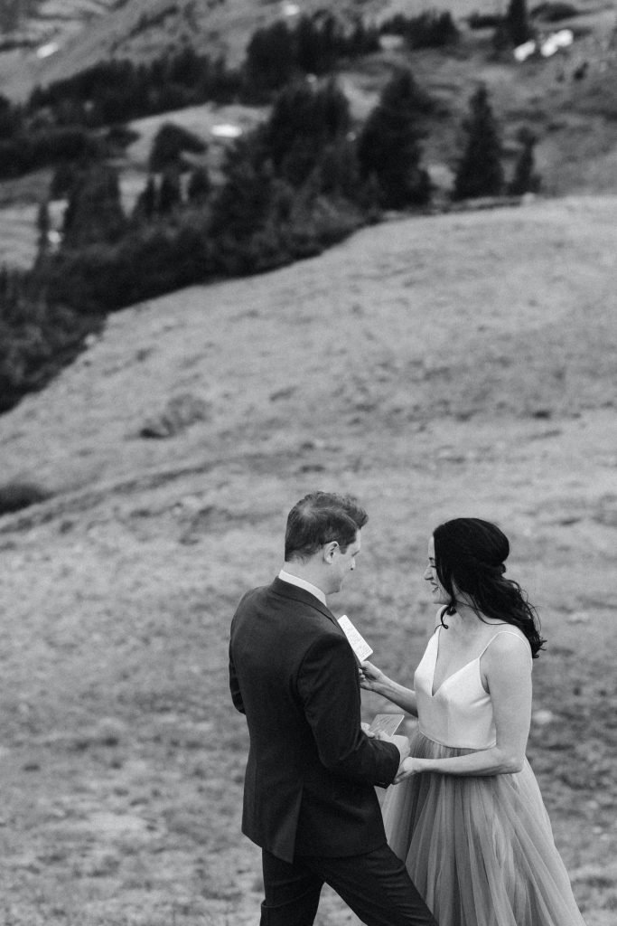 bride reading her vows during her Buena Vista elopement ceremony overlooking the mountains