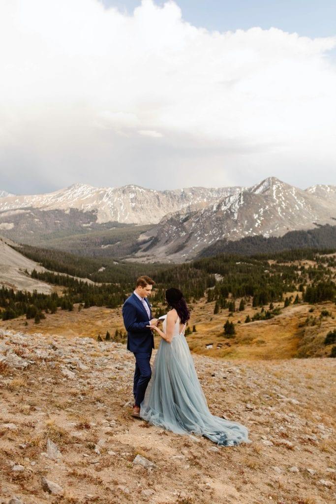 groom reading his vows during his Buena Vista elopement ceremony