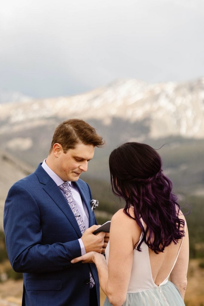 groom reading his vows during his Buena Vista elopement ceremony