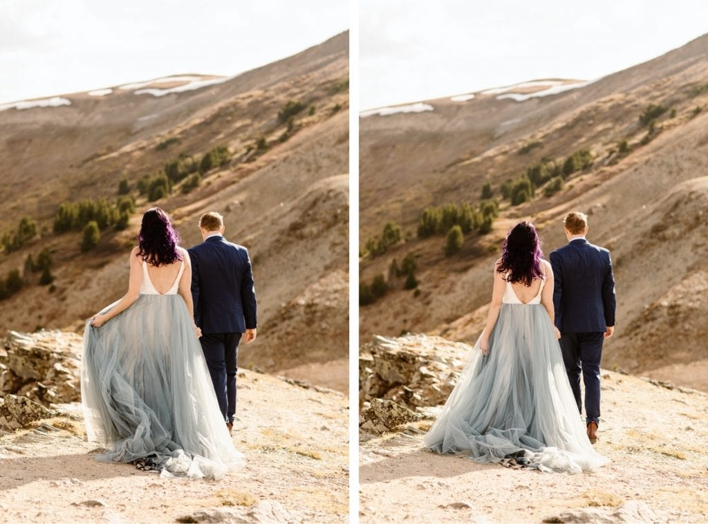 bride and groom hiking down the trail during their Buena Vista elopement