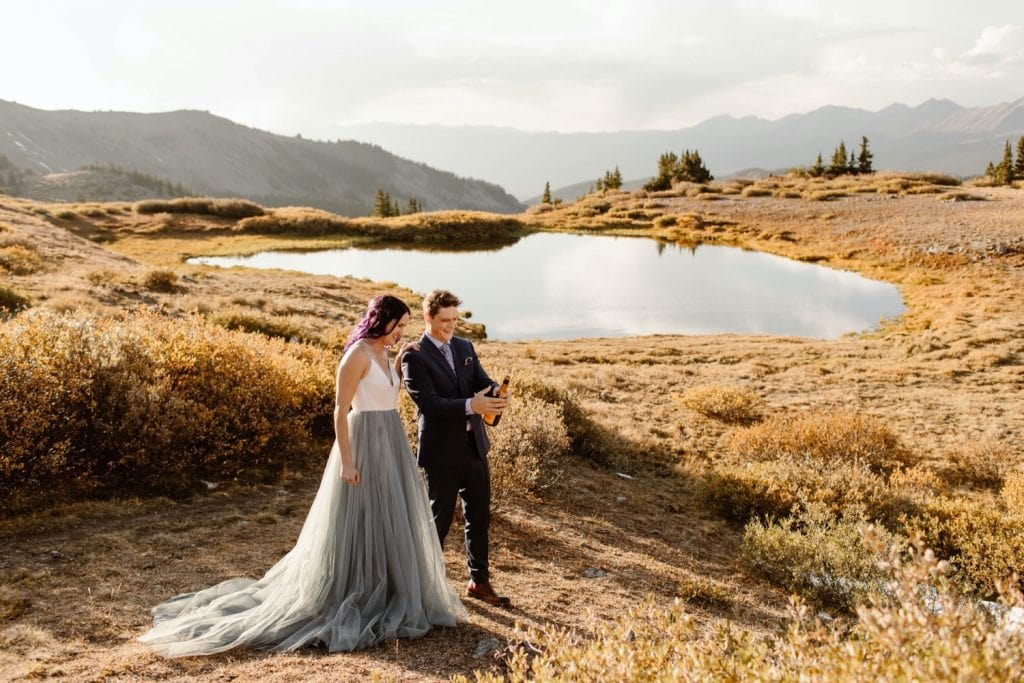 eloping couple popping champagne