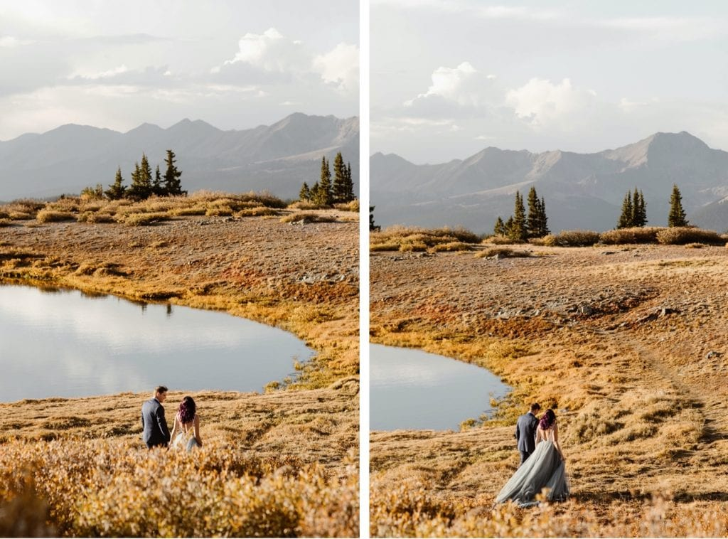 bride and groom walking down a hiking trail alongside a lake in the mountains of Buena Vista Colorado