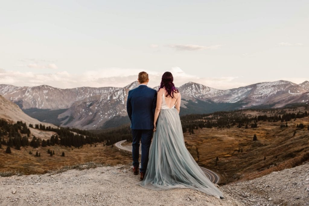 couple enjoying the view of the mountains after their Buena Vista elopement