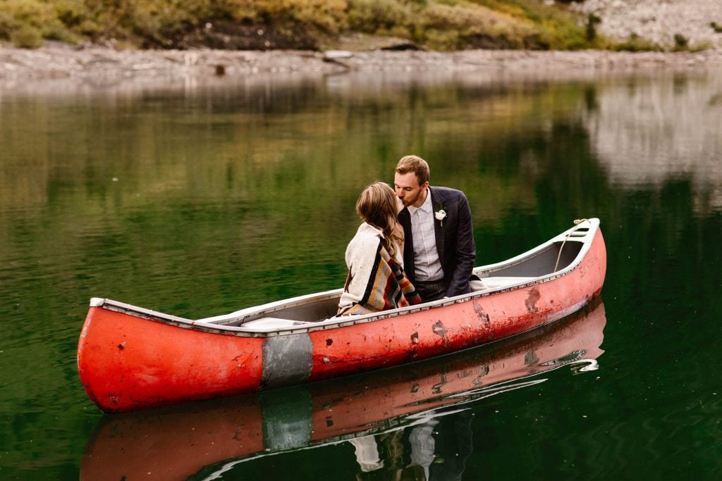 Crested Butte elopement photo of a couple kissing in a canoe on the water