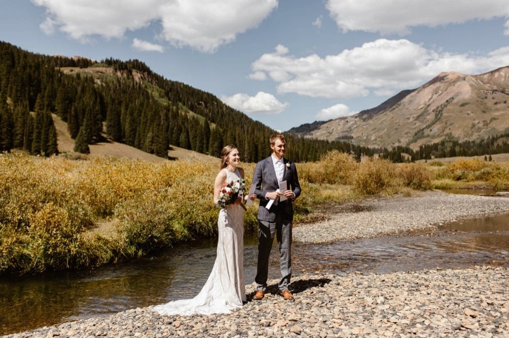 bride and groom reading a poem during their Crested Butte elopement ceremony