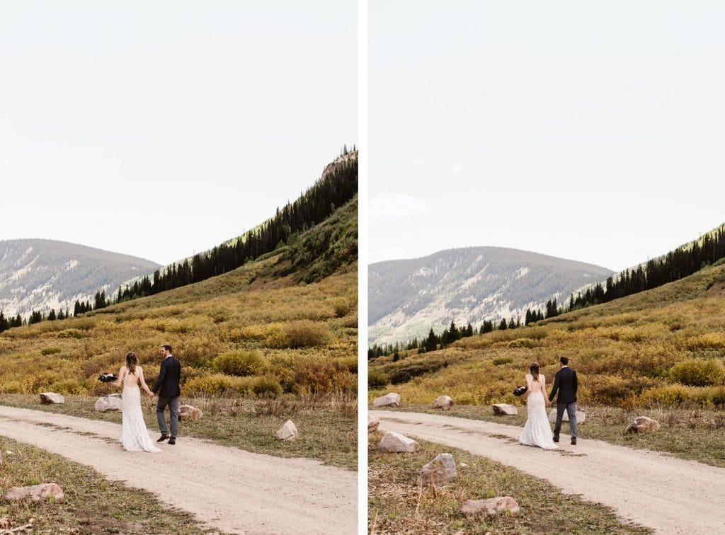 Crested Butte elopement couple running down a dirt road in the mountains