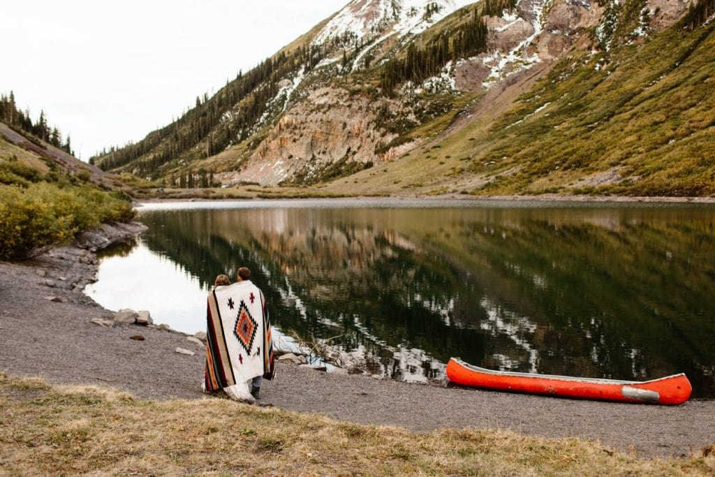 Crested Butte elopement adventures | couple running down the shoreline of an alpine lake in CB