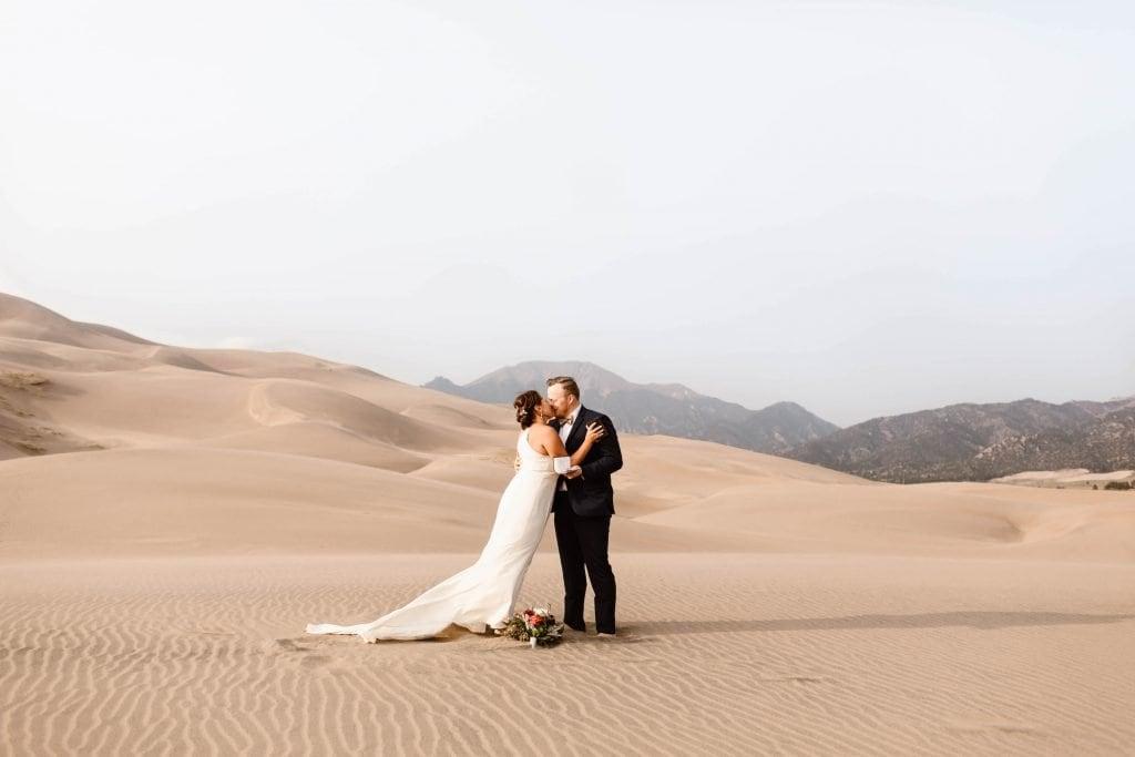 Great Sand Dunes National Park elopement first kiss