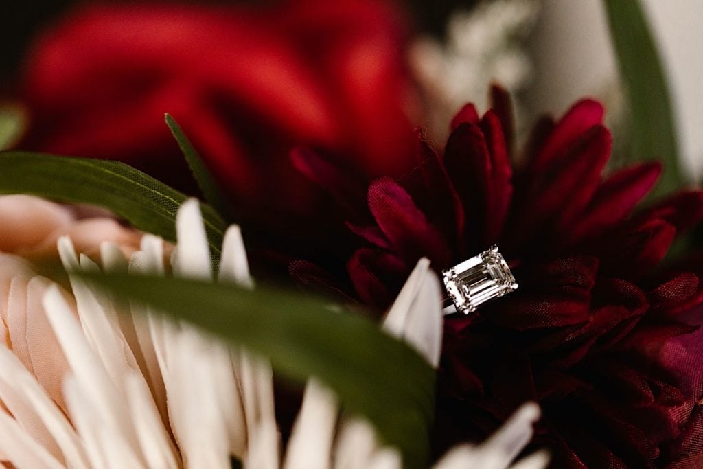 engagement ring sitting in an elopement bouquet