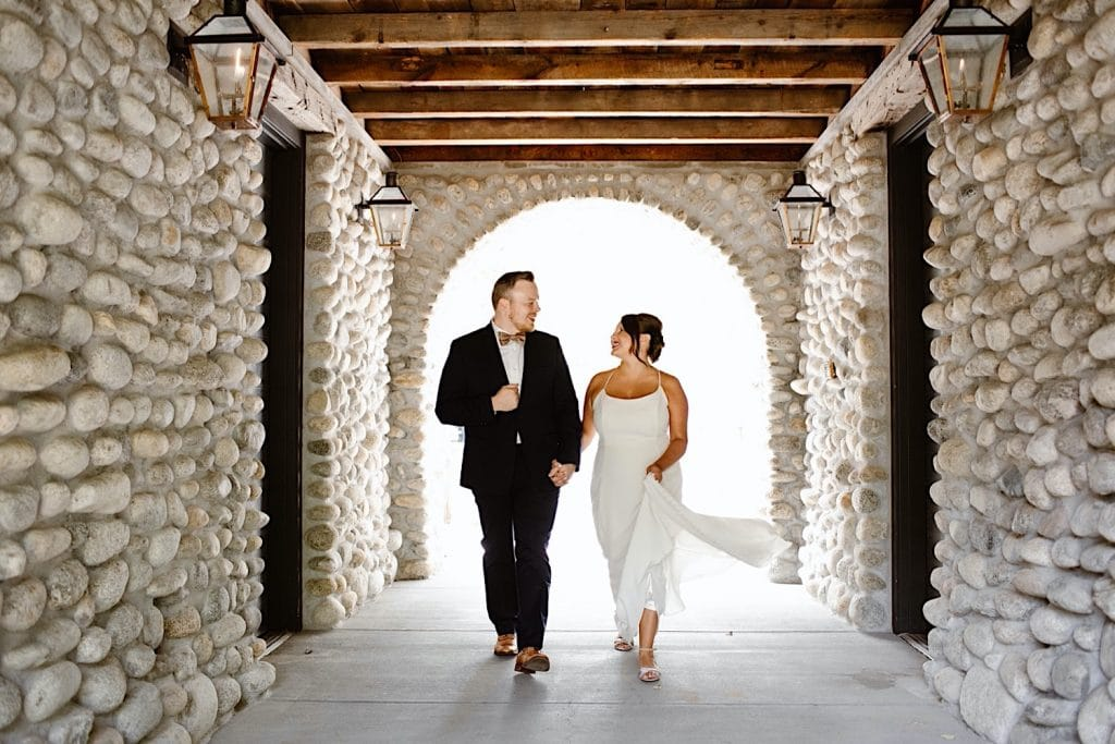 bride and groom walking through tunnel at the Surf Hotel Buena Vista before leaving for their Great Sand Dunes National Park elopement