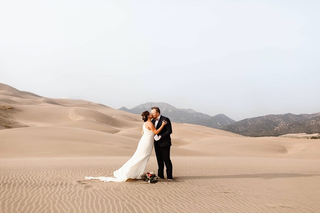 Great Sand Dunes National Park elopement first kiss