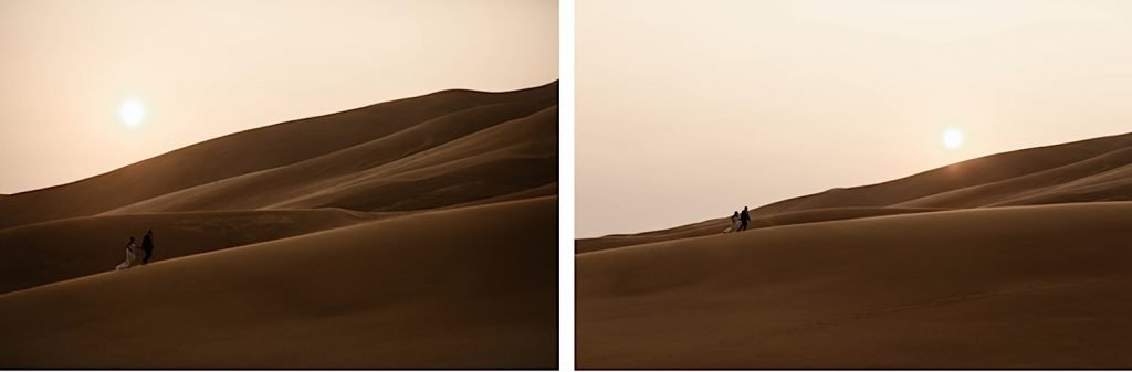 eloping couple hiking up the sand dunes at Great Sand Dunes National Park